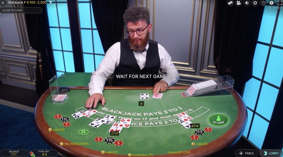 live casino dealer online working on a blackjack table